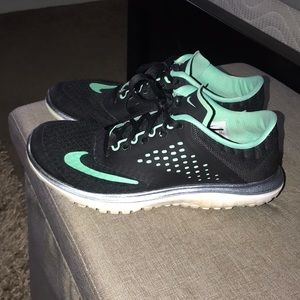 Black and teal Nikes